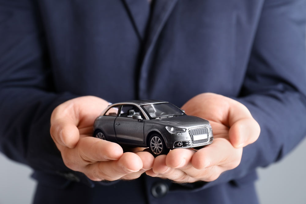 Media and Press - man holding a car in his hands