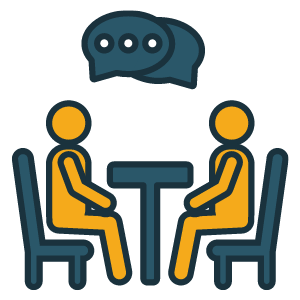 two stick people dialoguing at table
